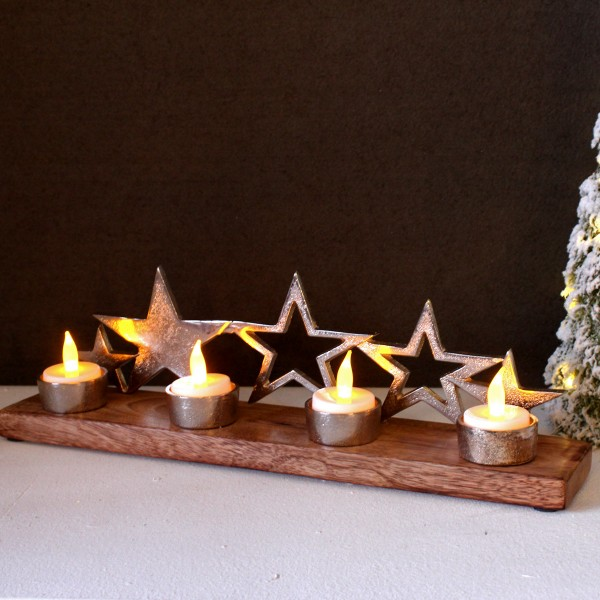 Teelichthalter mit silbernen Sternen auf Holzplatte - für 4 Teelichter